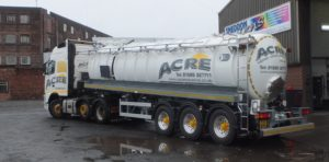 Liquid waste tanker and tractor unit fully repainted and lettered for a long time customer