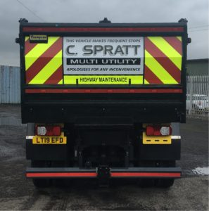 Customer graphics and chevrons installed on this tipper truck