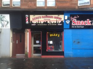Printed flat panel sign installed on a barber shop frontage