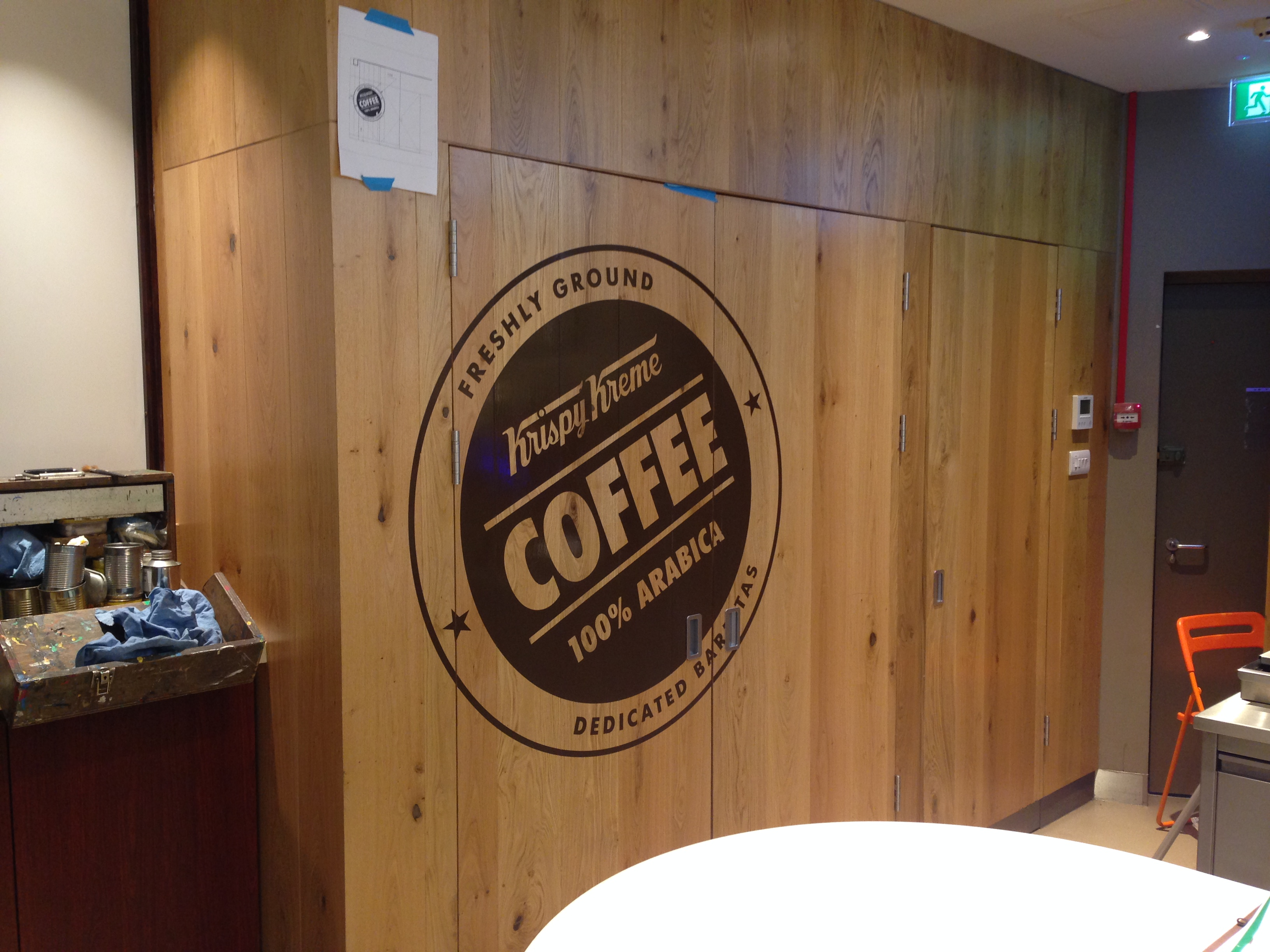 Traditional signwriting skills combined with cutting edge technology to create this painted logo in Glasgow