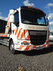 Reflective recvery truck livery using the same products as emergency vehicles to ensure driver safety