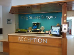 Stand off (back wall) and flat cut (Reception desk) letters have a clean look as seen at a doctor's surgery reception