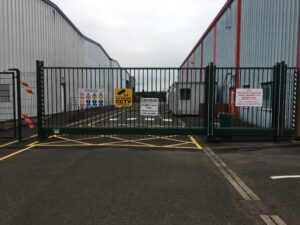 safety sign on a factory gate includig bespoke pictograms