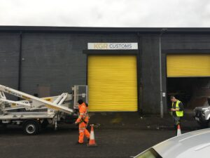 Photo of sign erected above a commercial shutter door