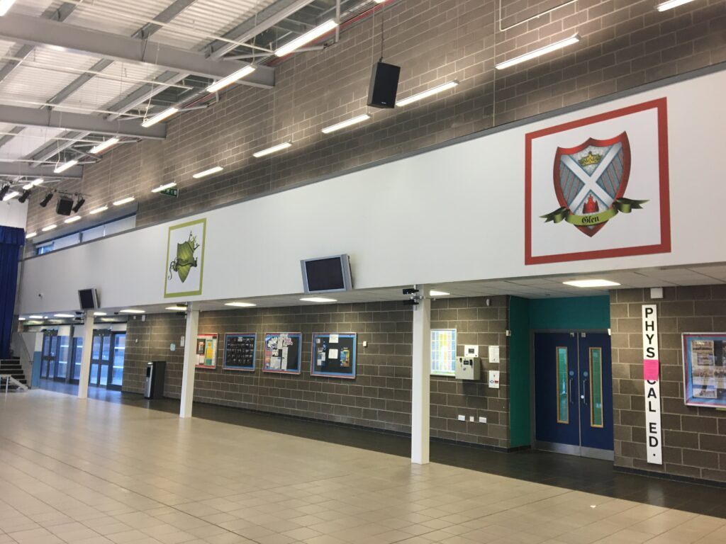 2 House crest signs at a high school