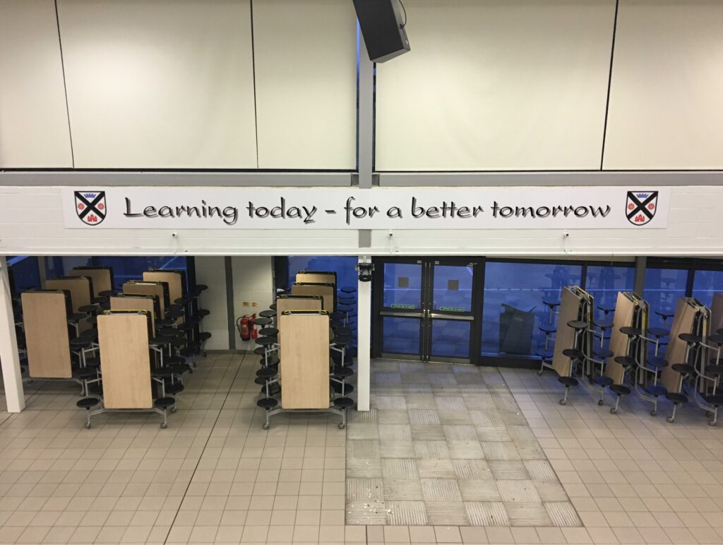 Picture of large school motto sign