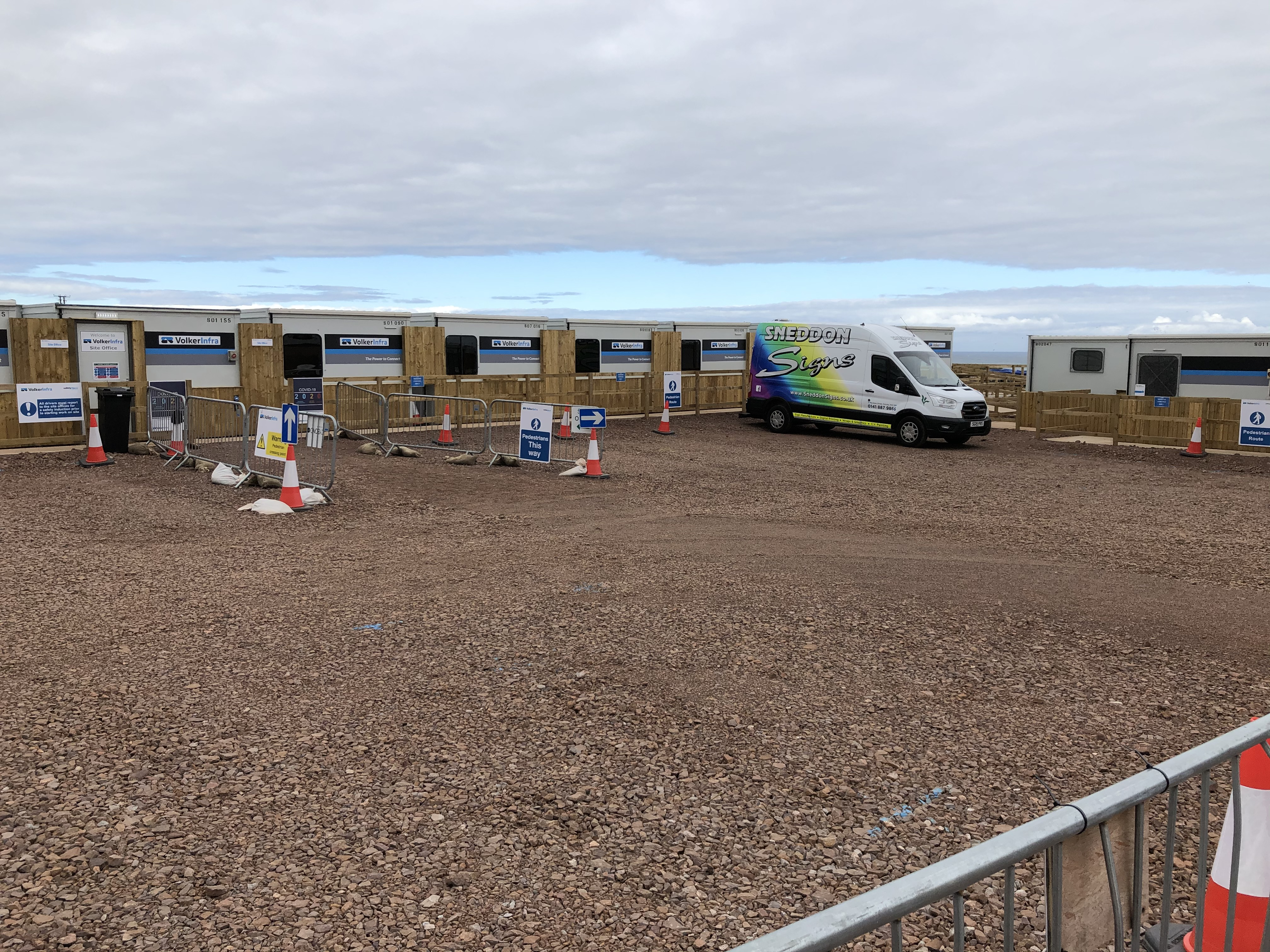 The cabins with their colour flashes fitted and fencing built, giving a much nicer look to the site