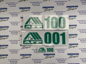 Photo of fleet number labels with bespoke logo